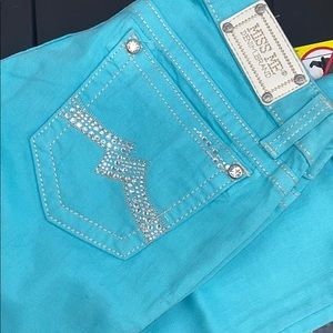 Aqua Miss Me cuffed skinny jeans from The Buckle